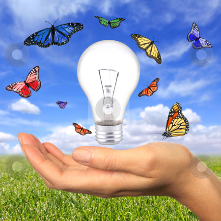 Renewable Energy is Within Our Reach stock photo, Woman Holding Lighbulb Concept of Clean Renewable Energy of the Future by Katrina Brown