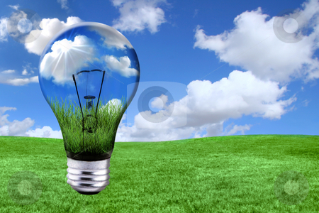 Green Energy Solutions With Light Bulb Morphed Into Landscape stock photo, Global Concept of Green Energy Solutions With Light bulb and Planet on Bright Landscape by Katrina Brown