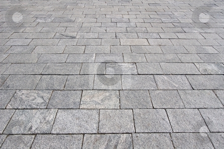 Pavement stock photo, Grey granite pavement seen in a wide angle perspective by Anders Peter