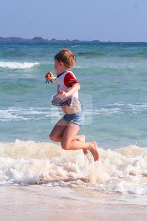 Having fun stock photo, Young boy by Yvonne Bogdanski