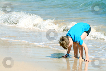 On the beach stock photo, Young boy on the beach by Yvonne Bogdanski