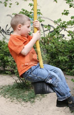 On the playground stock photo, Young boy by Yvonne Bogdanski