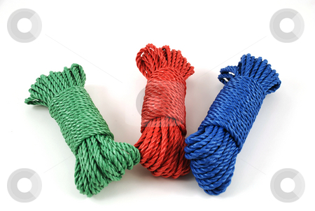 Multicolor rope stock photo, Three coils of rope in green, blue and red by Albert Lozano
