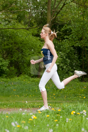 Jogging around stock photo, Young girl is  jogging in the nature by Frenk and Danielle Kaufmann
