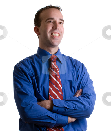 Business Portrait stock photo, Closeup view of a young businessman standing with his arms crossed with a shadow along the right side of his body and face by Richard Nelson