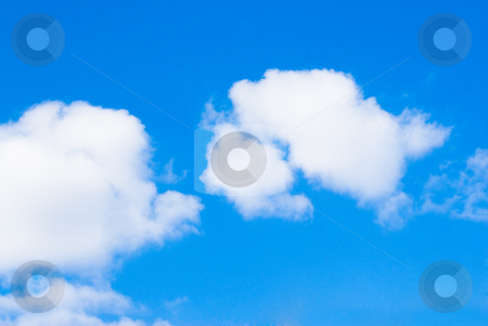 Fluffy Clouds stock photo, Fluffy clouds shot in a blue sky on a sunny day by Richard Nelson