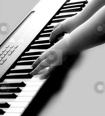 Music stock photo, Closeup view of someone playing some music on an electronic keyboard by Richard Nelson