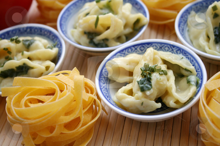Pasta with spinach stock photo, Pasta with spinach by Yvonne Bogdanski