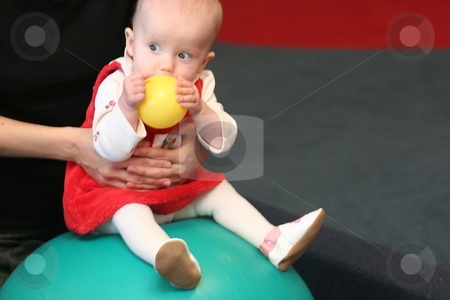 Balls stock photo, Cute little caucasian baby girl playing with colorful plastic balls. by Mariusz Jurgielewicz