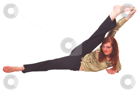Acrobatic girl. stock photo, A very flexible young teenager sitting on the floor and stretching one leg over her head. by Horst Petzold
