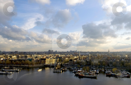 Amsterdam sunlight stock photo, The skyline of Amsterdam, basking in the warm spring sunlight. by Corepics VOF