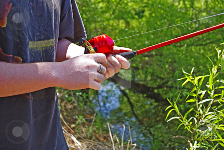 Gone Fishin' stock photo, Close up of young man with fishing pole by Sandra Fann