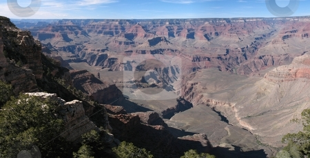 A Panorama of the Grand Canyon, South Rim stock photo, A panorama of the famous Grand Canyon, South Rim, on a beautiful sunny day in April. by Ray Carpenter