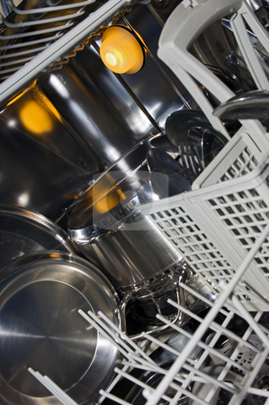 Dishwasher interior stock photo, The interior of a dishwasher, with damp stainless steel, pots, pans and cutlery by Corepics VOF