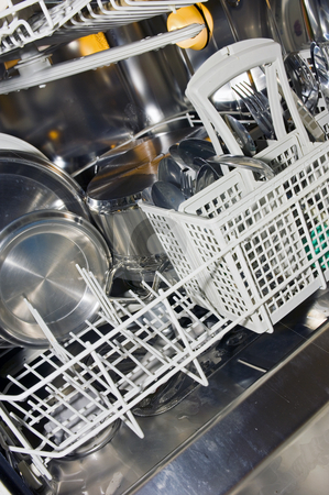 Dishwasher interior stock photo, The interior of a dishwasher, with pots, pans, dishware and cutlery. by Corepics VOF