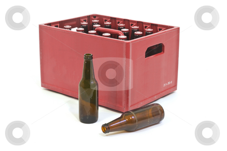 Red crate stock photo, Red Beer crate with two empty bottles in front by Corepics VOF