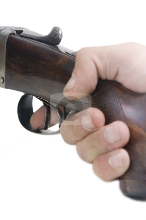 Finger on the trigger stock photo, The index finger on the trigger of a shotgun, ready to fire by Corepics VOF