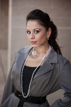 Pretty Hispanic Businesswoman stock photo, Pretty Hispanic woman in a business suit by Scott Griessel