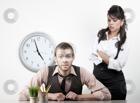 Woman angry with a male coworker stock photo, Woman at work wngry with male coworker by Scott Griessel