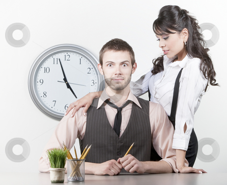Man receiving attention from a pretty coworker stock photo, Man receiving attention from a pretty Hispanic coworker by Scott Griessel