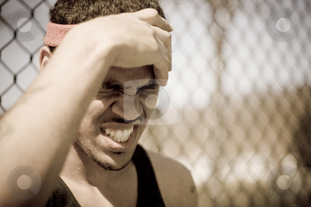 Frustrated Athlete stock photo, A young athlete grabs his forehead in anger or pain. by Todd Arena
