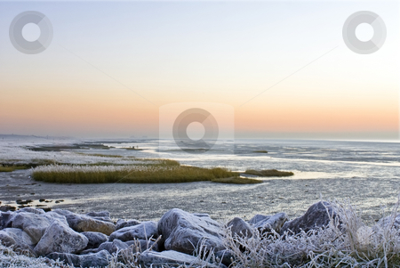 Winter landscape stock photo, The frosted sea-side on the Westerschelde, Zeeland, the Netherlands early morning. by Corepics VOF