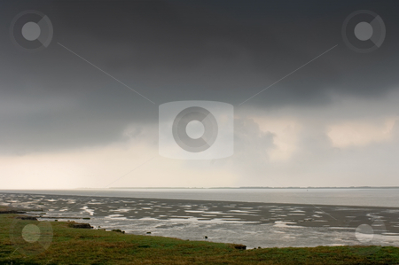 Pregnant Sky stock photo, A thunderous sky over the Wester Schelde at low tide in Zeeland, the Netherlands by Corepics VOF