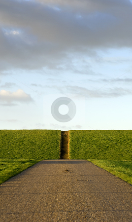 Road and steps stock photo, A rural road, leading towards a dyke, and ending into a flight of steps by Corepics VOF