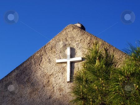Cross stock photo, White cross on the old stone church somewhere in Croatia by Sinisa Botas