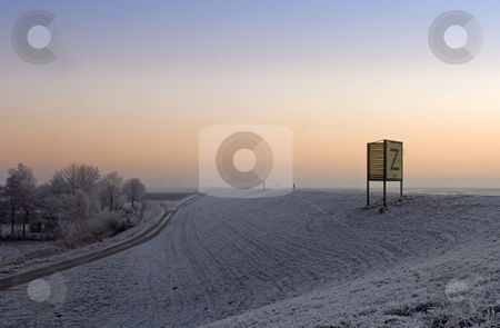 Sea-dike Zeeland stock photo, The frosted face of a high Sea-dike in Zeeland, the Netherlands, on a cold winter morning by Corepics VOF