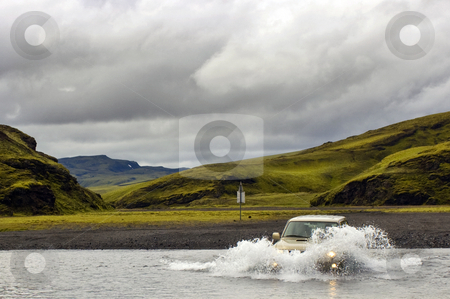 River Crossing stock photo, A four by four vehicle crossing a river in the Landmannalaugar area, Iceland. by Corepics VOF