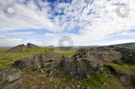 Lava formations stock photo, Erratic lava formations across the tundra over the volcanic mountain range the Kerlingafjoll in Hveravellir; an area on the atlantic ridge, separating the Eurasian plate form the North American plate by Corepics VOF