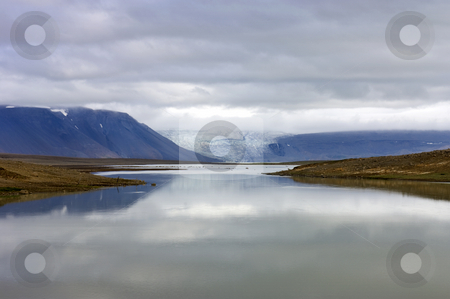 Glacier Lake stock photo, The lake and volcanic landscape around the Kjolur Highland Route with an overcast view on the Langjokull glacier, and the Hvitarvatn Glacier lake in Iceland by Corepics VOF