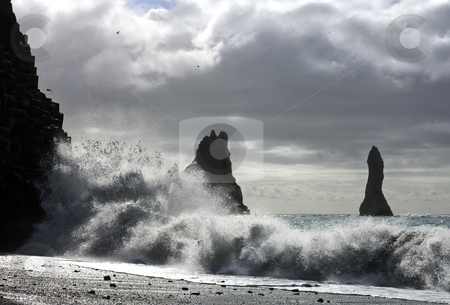Ocean splash stock photo, The waves of the Atlantic Ocean hitting the basalt and vulcanic beaches of Iceland's south coast at Reynir, famous for it's troll-like landmasses, erecting out from the ocean by Corepics VOF