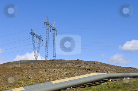 Geothermal Power and Hot water stock photo, Electricity and hot water, represented by the Power lines and insulated tubes, the products of Iceland's Geothermal activity by Corepics VOF