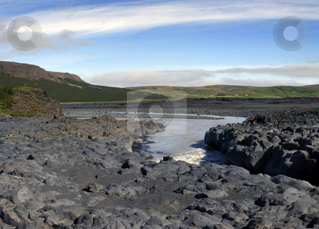 Basalt canyon stock photo, The volcanic basalt structures have given way to the eroding powers of the river, wearing out a steep canyon in the Icelandic rock formations by Corepics VOF