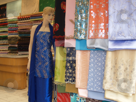 Store 01 stock photo, Mannequin standing in a textile shop by Jose .