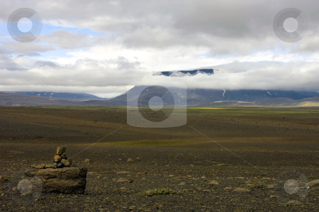 Sprengisandur stock photo, The vast, barren tundra landscape of the Sprengisandur Highland Road in Iceland, with the huge Vatnajokull volcanic glacier visible through the clouds. by Corepics VOF