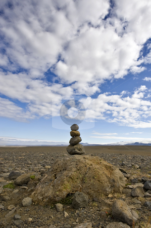 Stack of Rocks: Varda stock photo, A Varda is an Icelandic custom and an omen for a safe onward journey. For some, it represents Zen, for others, the stack of stone is merely a road side marker by Corepics VOF