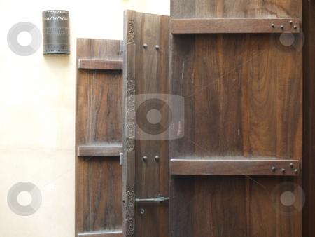 Door 01 stock photo, Three open doors made out of dark wood by Jose .