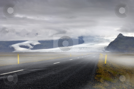 Icelandic Saga stock photo, The mystical feel of the road towards the Skaftafel National Park, with a view on the clearly lit Vatnajokull glacier's runners, the Skaftafellsjokull and the Svinafellsjokull by Corepics VOF