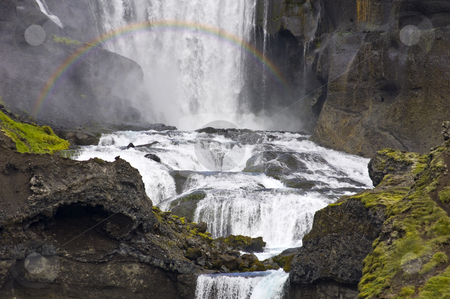 Ofaerufoss Waterfall stock photo, Close up of the Ofaerufoss waterfal in the Eldgja volcanic canyon of Iceland's Landmannalaugar national park with a rainbow in front by Corepics VOF