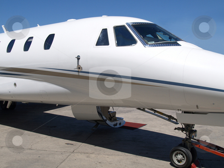 Private Jet 03 stock photo, Front view of a private jet by Jose .
