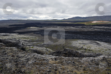 Lava Streams stock photo, The black lava streams, resulting from the 1984 eruption of the Krafla Volcanic System in Iceland is still warm, and provides the proof of the forces of nature by Corepics VOF