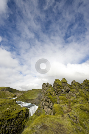 Sprengisandur Lava stock photo, A waterfall hurdling down into a lava formed canyon in Landmannalaugar, Iceland by Corepics VOF