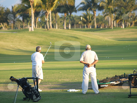 Golf PVR 01 stock photo, Two persons at a golf course by Jose .