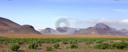 Transition to rocky Desert stock photo, The Icelandic landscape, with Tundra in front, a rocky desert in the middle and the volcanic highlands and glacier in the background by Corepics VOF