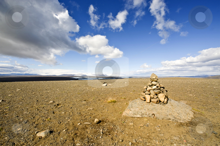 Stack of Stones stock photo, A Varda is an Icelandic custom and an omen for a safe onward journey. For some, it represents Zen, for others, the stack of stone is merely a road side marker by Corepics VOF