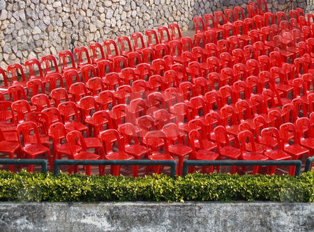 Red seats  stock photo, Empty red chairs aligned in rows by Jose .