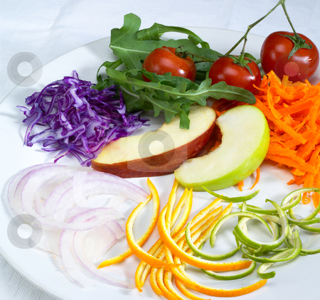Salad ingredient on a plate stock photo, Fresh salad ingredient prepared cutted on a plate by Francesco Perre